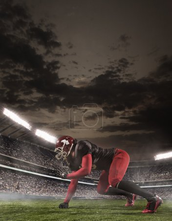 Photo for The american football player in action in stadium - Royalty Free Image