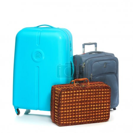 Photo for The modern and retro suitcases on a white background - Royalty Free Image