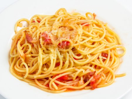Photo for Pasta with bacon and tomatoes isolated on white background - Royalty Free Image