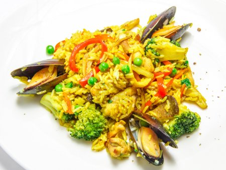 Spanish paella with mussels, food closeup