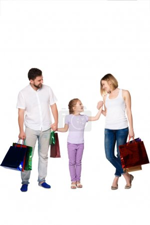 Photo for Happy family with shopping bags standing at studio, isolated on white background - Royalty Free Image