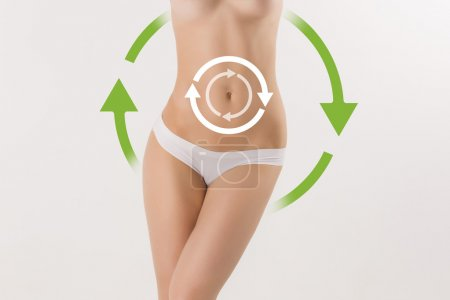 Women belly with the drawing arrows on it on white. Fat lose, liposuction and cellulite removal concept