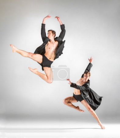 Photo pour Le collage du jeune danseur de ballet moderne attrayant sautant en veste noire sur fond gris - image libre de droit