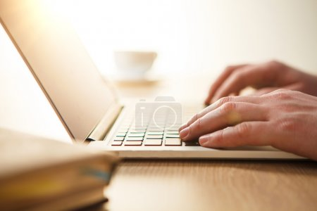 Photo for The male hands on the keyboard on the background of table - Royalty Free Image