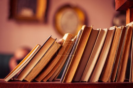Photo for Old books in library shelf. Horizontal orientation - Royalty Free Image