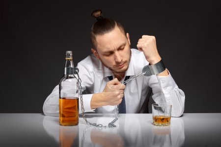 Young man businessman trying to free from addictio...