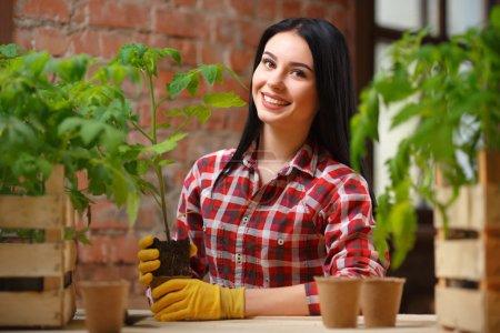 charming young woman gardening