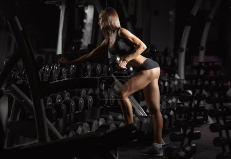 fitness woman with dumbbells in the gym