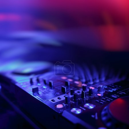 Photo for DJ mixer with light colored spotlights discos, shallow depth of field and beautiful swirling bokeh - Royalty Free Image