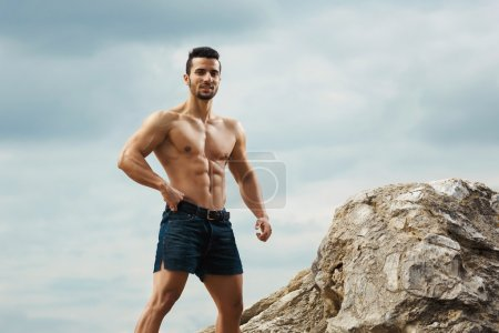 Athletic and muscular man with naked torso