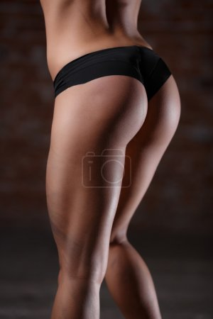 Beautiful athletic buttocks close-up