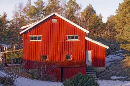 Red barn on farm in winter
