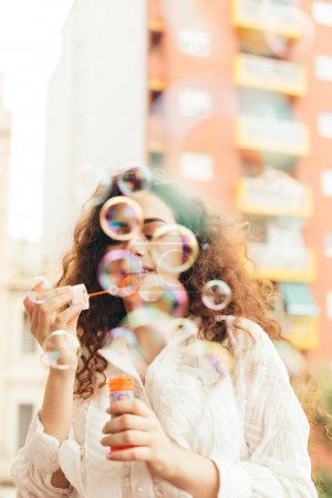 Girl playing with air bubbles.