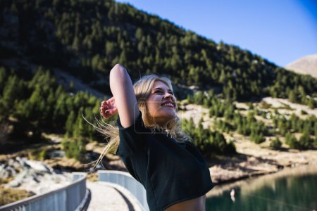 Blonde girl having fun in nature