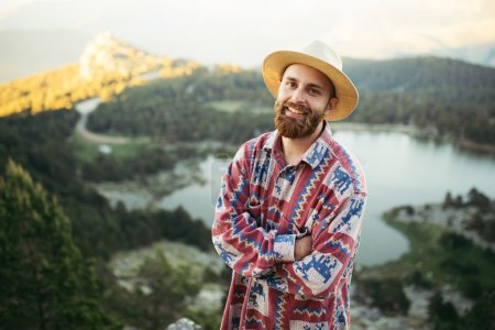 Man on hat smiling in nature