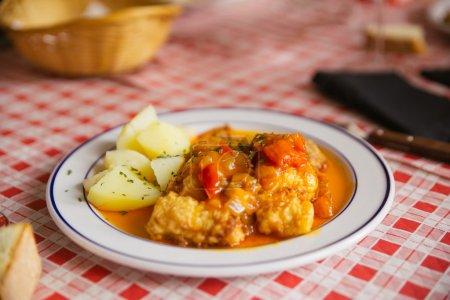 Dish of fish with potatoes