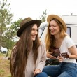 Two girls smiling supported in a van....