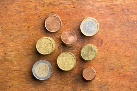 Euro coins in wood background