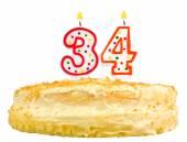 Narozeninový dort svíčky číslo třicet čtyři izolované