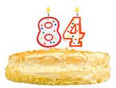 Narozeninový dort svíčky číslo osmdesát čtyři izolované
