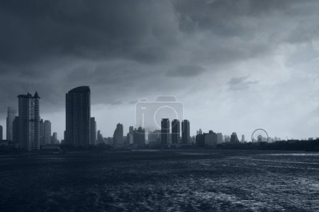 Photo for Skyline of Chao Praya river with a dark stormy sk - Royalty Free Image