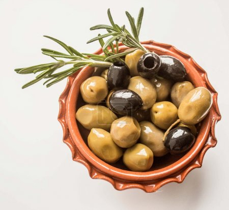 Olives into bowl