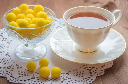 Candy lollipops with cup of tea