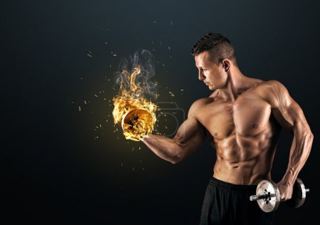 Photo for Handsome power athletic man bodybuilder doing exercises with dumbbell. Fitness muscular body on dark background. - Royalty Free Image