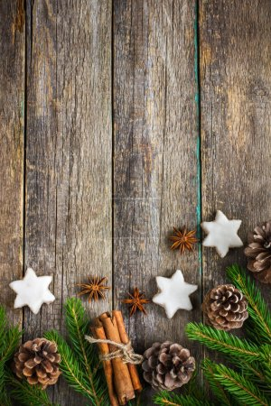 Christmas background with fir branches, pine cones, christmas co