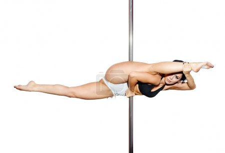 Photo for Young woman exercise pole dance isolated on white - Royalty Free Image