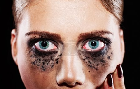 Hysteric woman with smeared makeup