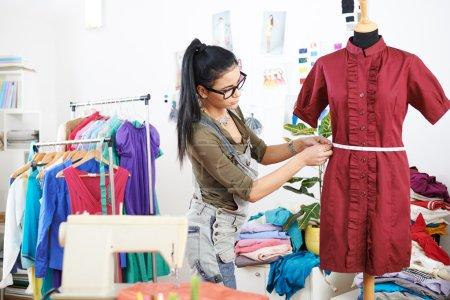Designer measuring dress