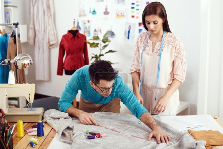 designers measuring material