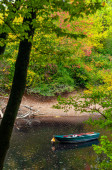 Mannheim, Germany. October 4th, 2009. Boat in the river in an autumn landscape in the