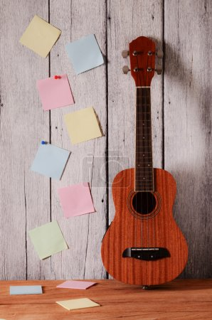ukulele guitar with note paper