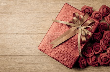 Photo for Red gift box on wood background - Royalty Free Image