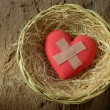 Wounded heart in basket...