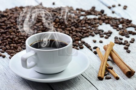Photo for White coffee cup with smoke and coffee beans around - Royalty Free Image