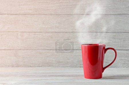 Photo for Red coffee cup on wooden table - Royalty Free Image