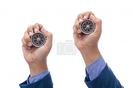 man hand holding compass isolated on white