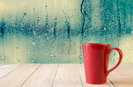 Photo for Red coffee cup with natural water drops on glass window background - Royalty Free Image