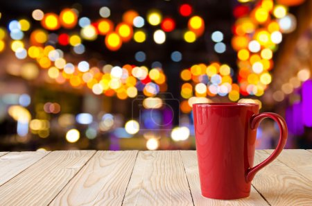 Red coffee cup with night bokeh background