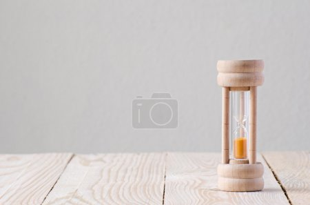 Sandglass on the wooden table