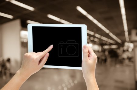woman hand holding the phone tablet on blur background