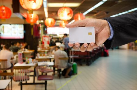 hand holding a blank smart card on blur background