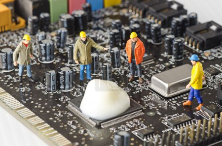 Miniature Technicians try to fix  the problem