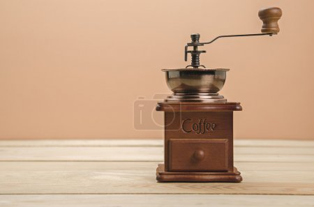 Coffee grinder on wooden table