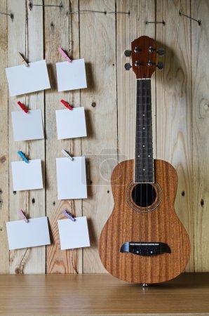 ukulele guitar with blank photo frame background
