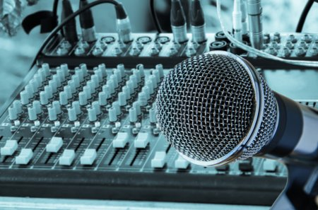 microphone with mixing audio console background