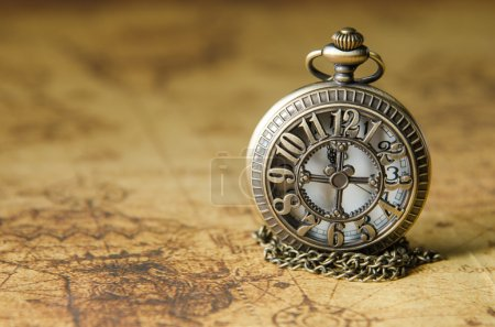 pocket or pendant watch on vintage map background
